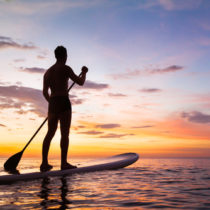 paddleboard on the beach at sunset, paddle standing in Thailand
