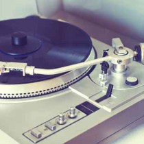 Vintage turntable playing LP